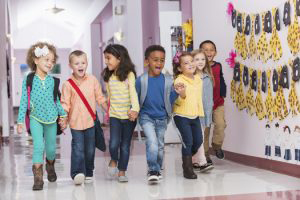 Small Children Walking in School Hall